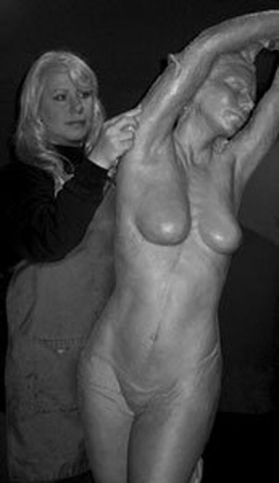 Bren Sibilsky working on Aphrodite, an award-winning sculpture. Notice how this picture emphasizes the scale of her work.