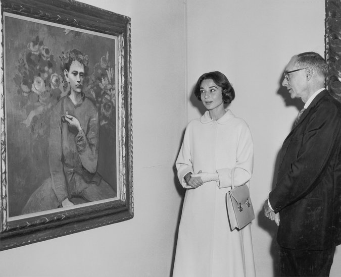Audrey Hepburn and Alfred H. Barr Jr. with a Picasso in 1957.CreditPhotography by Barry Kramer/The Museum of Modern Art Archives, New York; 2016 Estate of Pablo Picasso/Artists Rights Society (ARS), New York